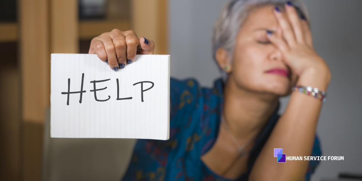 """woman holds sign that says """"help"""""""